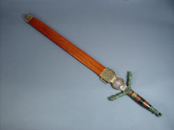 """Lycaon"" sheathed view (also called scabbard), with cast bronze chape, bronze fittings, handle of jade and exotic guayabillo hardwood"