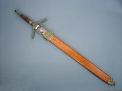 """Lycaon"" scabbard and sheathed view showing the lauan exotic hardwood scabbard with cast bronze chape, handmade"