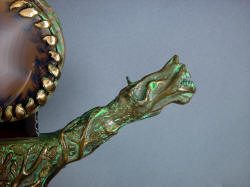 """Lycaon"" sword guard bronze detail, hand-cast in Enchanted Spirits Studio from original clay sculpture"