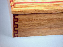 """Macha Navigator"" case joinery detail. Double dovetail in Red Oak and Redheart exotic hardwood"