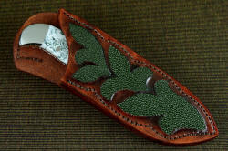 """Menkar"" sheathed view. Sheath has high back, allows easy access to knife  handle at the rear quillon, features very nice inlays of green rayskin in color progression hand-dyed leather"