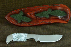 """Menkar"" reverse side view. Back of sheath and belt loop have inlays of green ray skin, with tonal gradation of hand-dyed leather, stitched with brown polyester"
