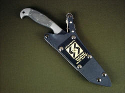 """Mercator"" PEW combat knife, sheathed view. Sheath is positively locking with all stainess steel mechanism, removable engraved flashplate honoring service."