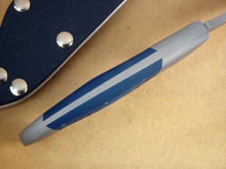 """Mercury Magnum"" spine view; note fully tapered tang with no filework to trap debris, full handle domed for comfort."