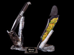 """Morta"" front left view. Knife sculpture with damascus blade knife on stand and hand-carved leather sheath on bronze stand"