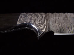 """Morta"" reverse side front bolster detail. bolsters are contoured polished, finished, and surfaces hand-engraved stainless steel"