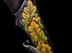 """Morta"" sheath and stand detail. Hand-dyed leather to reflect turning oak leaves and cycle of life"