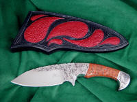 """Ocate"" fine handmade custom skinning, field dressing knife, obverse side view in engraved 440C high chromium stainless steel blade, 304 stainless steel bolsters, copper ore gemstone handle, red Stingray skin inlaid in hand-carved leather sheath"