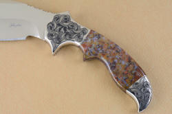 """Orion"" obverse side handle view. curves of handle and grip are echoed in hand-engraving of bolsters"