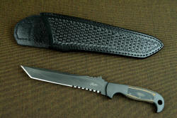 """PJ-CT"" obverse side view, front side of black basketweave sheath. This is a compact, narrow, aggressive blade"