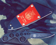 "USAF Pararescue ""Creature"", skeletonized blade in bead blasted and hot blued O1 high carbon tungsten-vanadium tool steel blade, engraved, tension fit sheath of kydex, aluminum, blued steel, engraved red lacquered brass flashplate"
