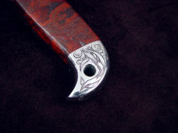 """PJLT Dragon"" obverse side rear bolster engraving detail. Engraved design matches main engraving on blade"