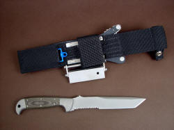 """PJLT"" CSAR, Tactical knife, reverse side view. Ultimate sheath belt loop extender lowers position to more traditional placement on belt line, but is removable and replaceable with die-formed aluminum belt loops which are reversible"
