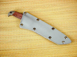 """PJLT"" sheathed view. Tension fit gray kydex sheath is deep and tight, securing knife well while protecting wearer"