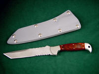 """PJLT"" obverse side view in bead blasted 440C high chromium stainless steel blade, 304 stainless steel bolsters, Stabilized Laminate Phenolic (Dymondwood) handle, gray kydex, aluminum, stainless steel sheath"