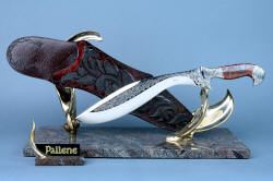 """Pallene"" custom handmade knife sculpture, front view. High technology tool steel blade, old world process lost wax casting, inlays of rayskin in leather, granite classic base"