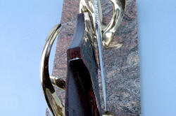 """Pallene"" custom handmade knife sculpture, photo illustrates close fit of knife blade and sheath resting in bronze stand."