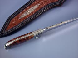 """Phobos"" spine filework, edgework details: filework pattern is bold and geometric, matching blade and handle shape."