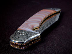 """Procyon"" is a large folding knife, one of the largest possible. Front bolster detail shows fully hand-fileworked anodized titanium liners and lock plate"