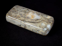 Polished and finished stone sarcophagus case for folding knife Procyon in brown Breccia Marble