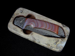 "Open case for ""Procyon"" folding knife in brown Breccia Marble"
