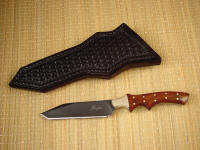"""Quark"" utility knife, obverse side view in blued O1 high carbon tungsten-vanadium tool steel blade, nickel silver bolsters, Honduras Rosewood hardwood handle, hand-tooled basket weave leather sheath"