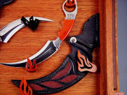 """Raptors"" (Tunguska and Manicouagan) note bolster engraving matches bloodwood hand-carved hangers."