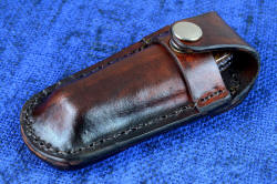 """Sadr"" linerlock folding knife, in pouch. Sheath is 5-6 oz. leather shoulder, dyed and sealed, dot snap is all stainless steel for durability and zero care"