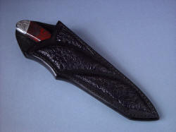 """Tharsis Intense"" sheathed view. Sheath is deep and protective in heavy leather shoulder and frog skin inlays"