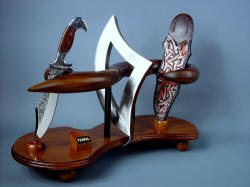 """Tribal"" knife and stand art form in stainless steel, hardwoods, leather."