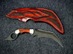 """Triton"" double edged kerambit, reverse side view. Note inlays of Cape Buffalo skin on back of sheath and belt loop."