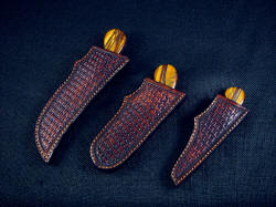 """Trophy Game Set"" sheathed view. Sheaths are protective and well made"