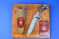 """Uvhash"" Custom Commemorative Pararescue Knife, obverse side view, in 440C high chromium stainless steel blade, 304 stainless steel bolsters, coyote/black G10 handle, hybrid tension lock kydex, anodized aluminum sheath, plaque in ash, engraved maroon lacquered brass"