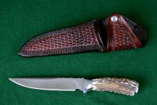 """Yarden"" obverse side view in CPMS30V powder metal technology high vanadium tool steel blade, 304 stainless steel guard and pommel, Sambar Stag handle, hand-stamped heavy leather sheath"