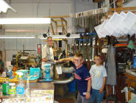 James, Malachi & Etienne in shop.