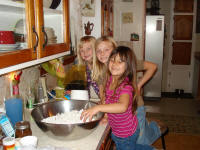 Averie, Addison, Kairi making popcorn