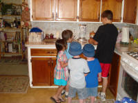 Kids making popcorn balls