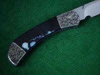 Black and white moss agate gemstone knife handle is tough and hard on this folding knife