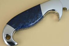 Dumortierite can be very dark blue, and is the hardest, toughest naturally blue gemstone appllicable for knife handles