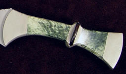 Nephrite Jade's toughness is due to interlocking microscopic fibrous crystals