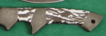 Zebra Marble on hidden tang tactical knife with central sub-hilt bolster in blued steel
