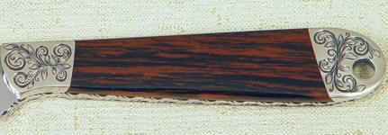 Mahogany Obsidian gemstone on full tang custom knife handle.