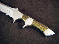 Australian Tiger Iron gemstone on a tactical combat knife with stainless steel fittings