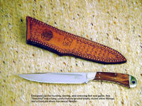 "The ""Sanchez"" boning knife is all business with a fine tapered blade and hardwood handle"