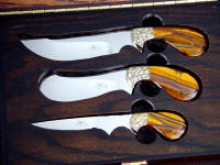 Trophy Game Set knives have hand-engraved brass bolsters and Tiger Eye Quartz gemstone handles