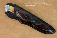 """Aldebaran"" sheath view in CPM154CM high molybdenum powder metal technology stainless steel blade, hand-engraved 304 stainless steel bolsters, Sunset Jasper gemstone  handle, hand-carved leather sheath inlaid with ostrich leg skin"