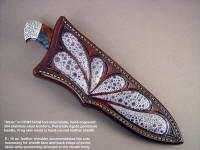 "Sheath detail: ""Altair"" with frog skin inlay, Pietersite gemstone handle, engraved stainless steel bolsters"