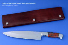 """Concordia"" fine master chef's knife, obverse side view in CPM154CM high molybdenum powder metal technology tool steel blade, 304 stainless steel bolsters, Brecciated African Jasper gemstone handle, chef's roll case in latigo side leather and leather shoulder, hand-tooled, hand stitched with stainless steel snaps"
