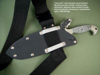 """Horrocks"" combat tactical knife with locking sheath and tactical sternum harness allowing wear of the knife handle down across the chest"