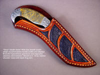 Sheath detail of Iraca knife in Bronzite Hypersthene handle, engraving, sheath display arrangement, protection of blade cutting edge and spine